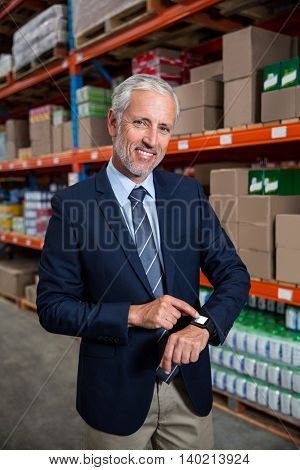 Manager posing for the camera in a warehouse