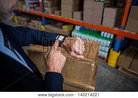 Focus on a smart watch in a warehouse