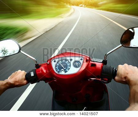 Driving a motorbike on an asphalt road