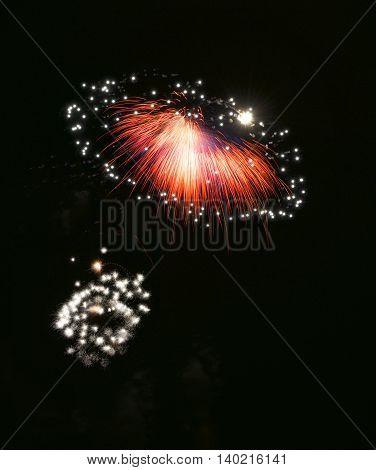 Colorful fireworks explode, red magenta violet fireworks background. Light art. Visual art. fireworks festival, Independence day, Bastilian day, freedom. Fireworks