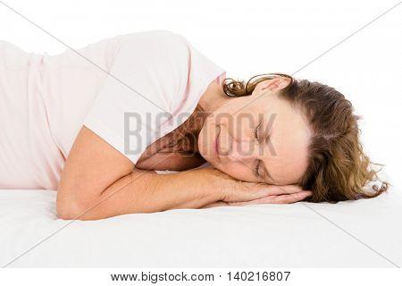 Woman sleeping on white sheet on white background