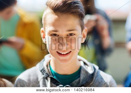 people and portrait concept - happy teenage boy face