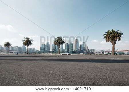 cityscape and skyline of chongqing in cloud sky on view from empty road