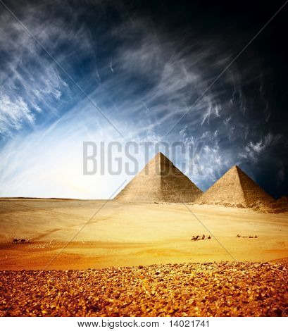 Greate pyramids in Giza valley with blue sky and clouds