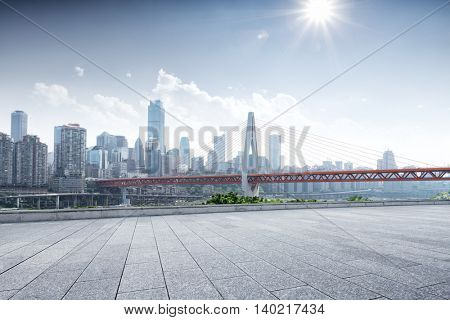 cityscape and skyline of downtown near bridge of chongqing with sunbeam from empty floor