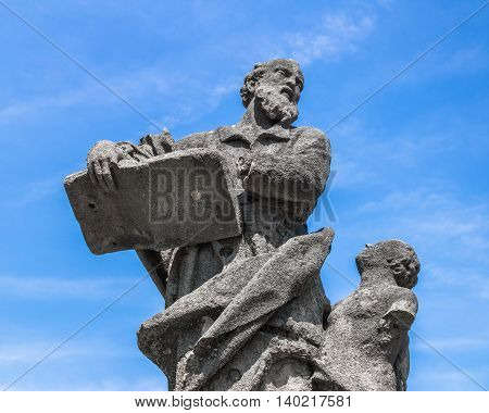 Statue of an old teacher with mutilated hand and his student.