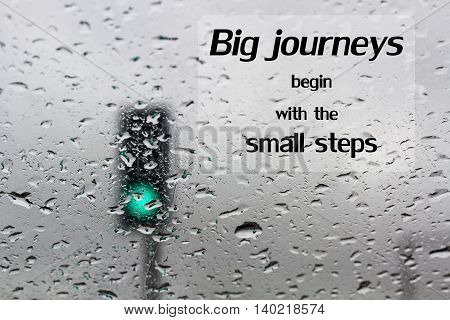 Word  Big Journeys Begin With The Small Steps.inspirational Motivational Quote On Traffic Light On A