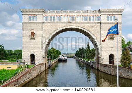 UGLICH RUSSIA - JULY 19 2016: Boat in navigable gateway of Uglich hydroelectric power station on river Volga Uglich Russia