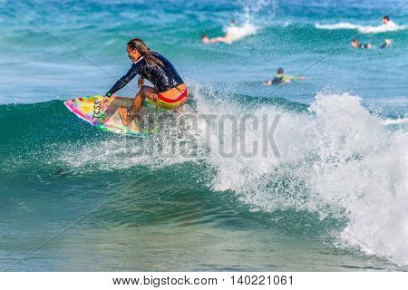 Sydney Australia - November 26 2014: A Australian surfer on the crest of a wave Bondi Beach in the Eastern Suburbs Sydney New South Wales Australia.