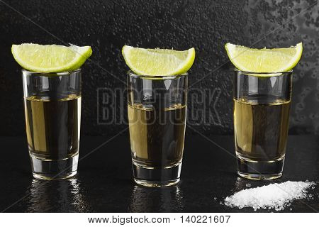 Tequila With Salt And Lime On A Dark Background