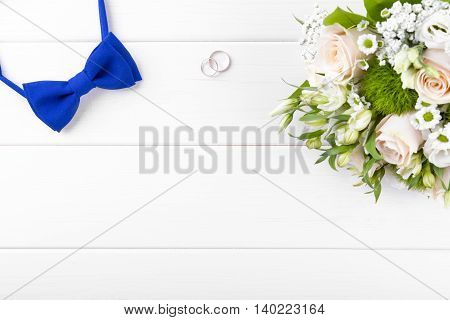 wedding accessories on white wooden table with copyspace
