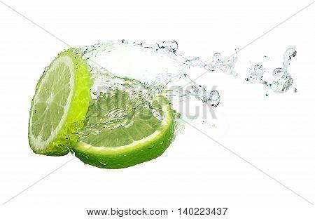 Water splash on lime slices on white ground