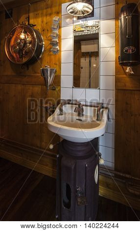 SVEG, SWEDEN ON JULY 08. Interior view of the Café Cineast on July 08, 2016 in Sveg, Sweden. Restroom furnished in imaginative style, retro equipment from the film, movie world. Editorial use.