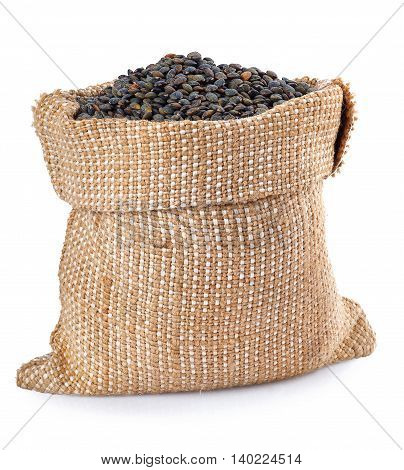 black lentils in burlap bag isolated on white background. Black beluga lentils. Super food