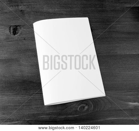 Blank catalog brochure book mock up. Empty closed magazine on wooden background