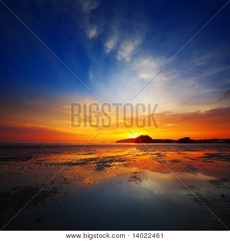 Sunset over beach during ebb