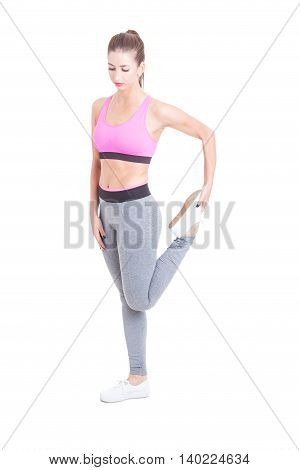 Woman Standing And Stretching Her Legs Before Workout
