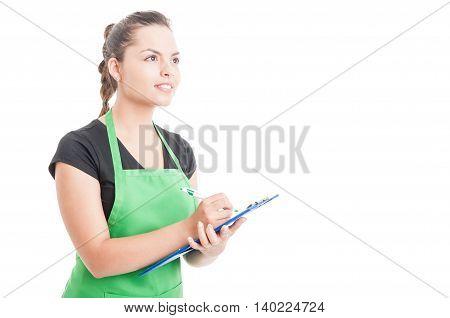 Supermarket Female Clerk Writing On Checklist