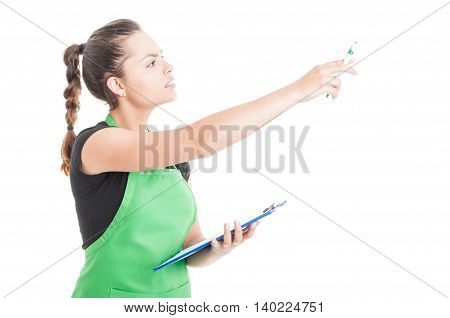 Young Female Employee Holding Clipboard And Pointing Finger