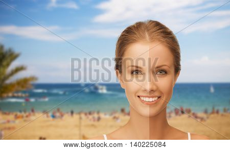 people, suntan, travel and summer holidays concept - close up of beautiful smiling woman with half face tanned over resort beach background