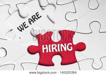 HIRING concept.  Missing Piece Jigsaw Puzzle with word.