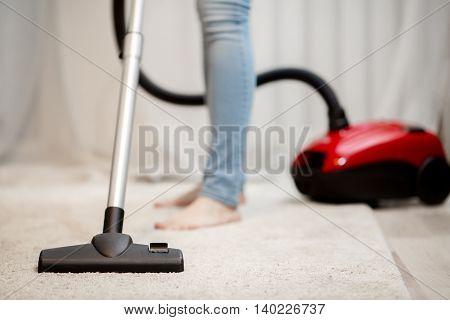 People and housekeeping. Closeup of head of modern vacuum cleaner