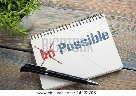 Impossible change transformed into Possible written on notebook page.
