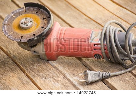 Red steel cutter  on wooden  background suitable for background masonry and craftsman tool or equipment or household or background tool.