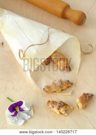 Small Homemade Rugelach with Sugar, One Cut in Half