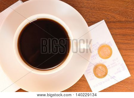 coffee on a wooden table with money
