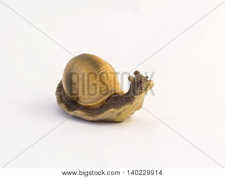 Clay figurine of a crawling snail on a white background