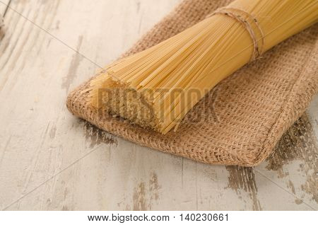 pasta from above pouch on the wooden background