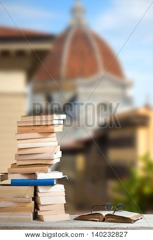 Stack of Travel Guides before the Duomo in Florence