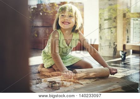 Little Girl Smiling Bake Cookie Concept