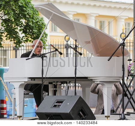 St. Petersburg, Russia - 23 July, The musician playing the piano, 23 July, 2016. Speech by David Goloschekin with his jazz group on the Arts Square in St. Petersburg.