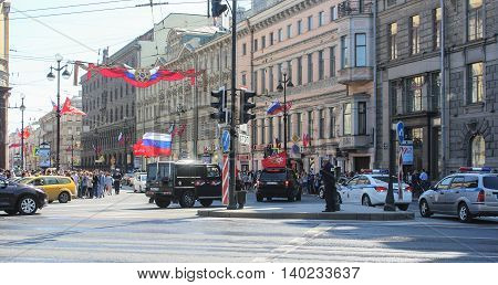 St. Petersburg, Russia - 9 May, SUVs with festive flags on Nevsky Prospekt, 9 May, 2016. Celebration day of victory in the center of St. Petersburg.