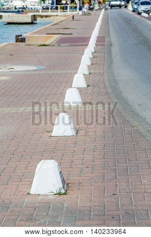 Concrete Barriers by Road on Sidewalk in Bonaire