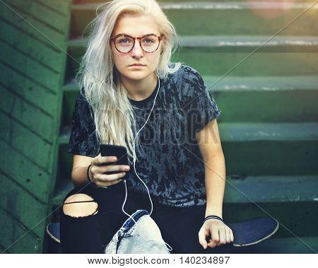 Skateboard Girl Listening Music Concept