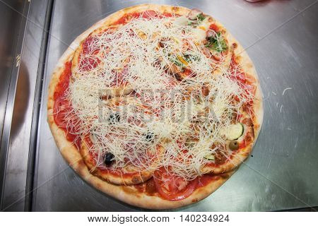 big pizza with four small