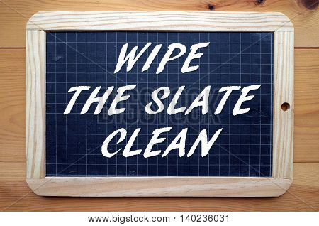 The words Wipe The Slate Clean in  white text on a blackboard meaning you intend to make a fresh start