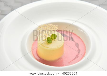 Pudding cake on white plate in restaurant