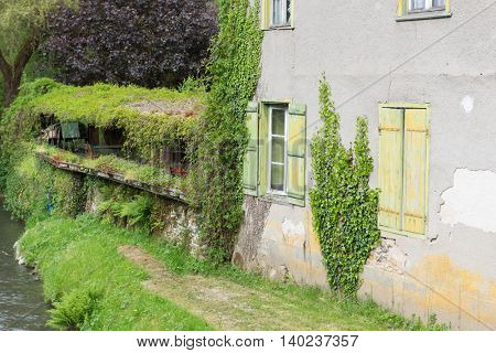 French house with green shutters