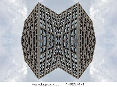 Bottom view on skyscraper on a background of blue sky