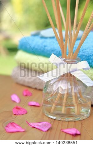 Aromatherapy Reed Difuser Bottle In A Beautiful Outdoor Setting In Morning Sunlight