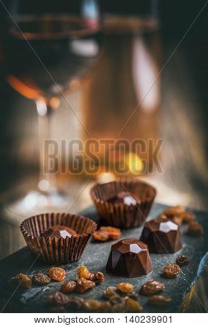 Chocolate sweets on black background, studio shot