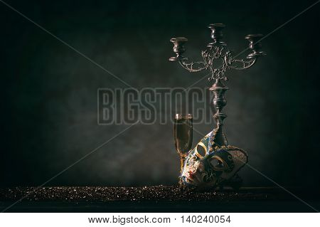 Carnival mask with candlestick and champagne, copy space