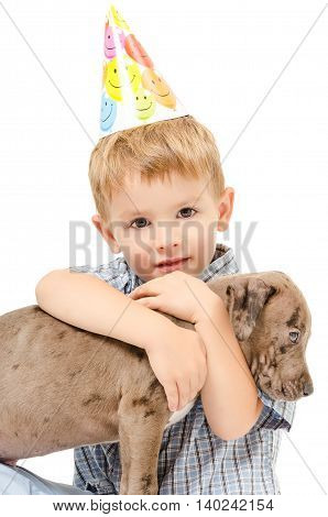 Cute boy hugging a pit bull puppy isolated on white background