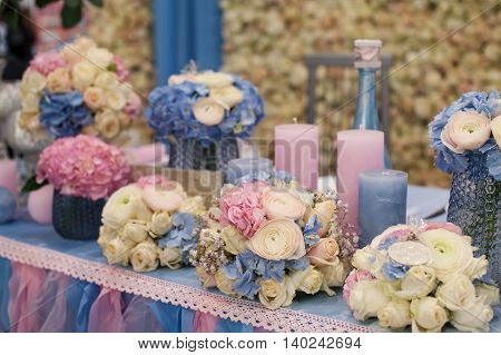 Wedding decoration of flowers and candles on the table in a restaurant.
