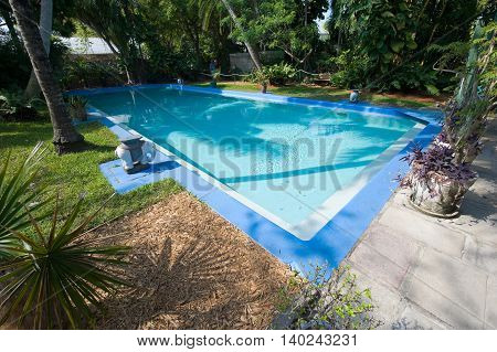 KEY WEST FLORIDA USA - MAY 03 2016: Swimming pool in the garden of the Hemingway House in Key West in Florida.