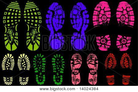 colored Vector illustration of various shoe print traces